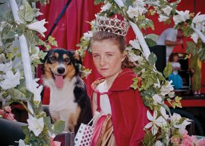 "Rose Queen of Hale, Leoni Topping with consort Denby. ""She was driven through the village in an open top classic car. Seventy children followed behind in an open top bus and Rosebuds travelled in a trailer."""